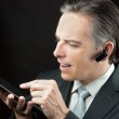 Businessman Wearing Headset Using Tablet — Stock Photo #31559769