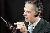 Businessman Wearing Headset Using Tablet — Stock Photo