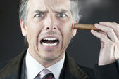 Stressed Businessman Stubs Out Cigar On Face — Stock Photo