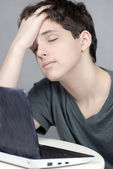 Exhausted Teen Works On Computer — Stock Photo