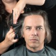 Stock Photo: MGetting Long Hair Cut Off For Cancer Fundraiser