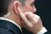 Secret Service Agent Listens To Earpiece, Close Side — Stock Photo