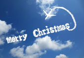 Merry christmas word written in the cloudy sky — Stock Photo