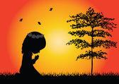 Little girl praying silhouette — 图库矢量图片