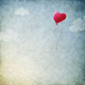 Grunge background with heart balloon — Стоковое фото