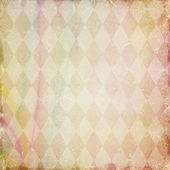 Grunge background with harlequin pattern — Stock Photo