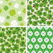 Set of seamless clover patterns — Stock Vector