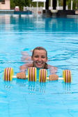 Aqua aerobic, woman in water with dumbbells — Stock Photo