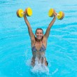 Woman is engaged aqua aerobics in water — Stock Photo