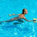 Woman is engaged aqua aerobics in water — Stock Photo