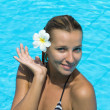 Young woman relaxing in the water. swimming pool. Summer. — Stock Photo