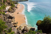 View of the beautiful beach where people are surfing in water. Bali. Balangan — Stock Photo