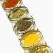 Herbs and spices in glass jars, isolated on white background — Stock Photo