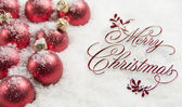 Merry Christmas Sign and Ornaments in Snow — Stock Photo