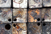 Old oil tin packing is stacked — ストック写真