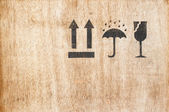 Safety fragile icon on wood board with space — Stock Photo