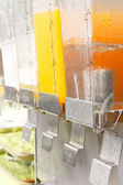 Orange juice in dispenser  — Stock Photo
