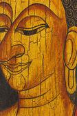 Face of buddha, Thai style painted on wood — Stock Photo