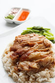 Pork leg with rice isolated on white background — Stock Photo