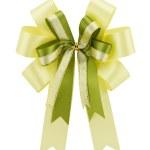 Yellow ribbon gift bow isolated on white background — Stock Photo #44004897