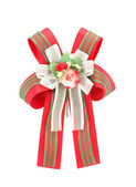 Green and red bow with artificial rose flowers on white backgrou — Stock Photo