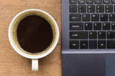 Top view of coffee cup , laptop on wooden table — Stock Photo