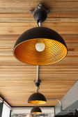 Modern lamp on wooden ceiling — Stock Photo