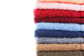 Colorful towels isolated on white background — Stock Photo