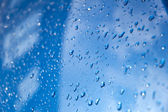 Water drops on a blue car — Stock Photo
