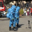 Stock Photo: Fire rescue unit in anticehmical suits