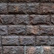 Stone  faceted wall — Stock Photo