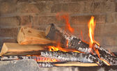 Hearth and home fire in the fireplace — Photo