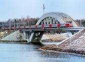 Railway bridge across the river in the city — Stock Photo