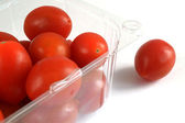 Cherry tomatoes are in plastic utensils  — Foto Stock