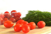 Cherry tomatoes and dill — Stock Photo