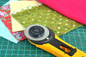Rotary knife and pieces of cloth for patchwork — Photo