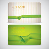 Gift cards with green ribbons — Stock Vector