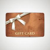 Geschenkkarte mit grunge karton textur und weiße band — Stockvektor