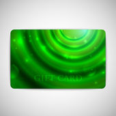 Green gift card with sparkles — Stock Vector