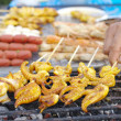 Stock Photo: Grilled Squid on other grilled food background