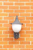 Lamp on Brown Brick wall — Stock Photo