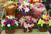 Colorful flowers bouquet on the table in market — Stock Photo