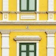 Yellow windows wall in bangkok, thailand — Stock Photo