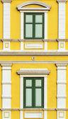 Yellow windows wall in bangkok, thailand — Stock Photo