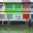 Multi color Thai style houses beside canal, samut songkhram, Tha — Stock Photo