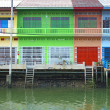 Multi color Thai style houses beside canal, samut songkhram, Tha — Stock Photo #32247617