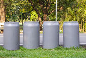 Four recycle bins in the park — Stock Photo