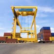 Trading port cranes and container storage with truck — Stock Photo #32317365