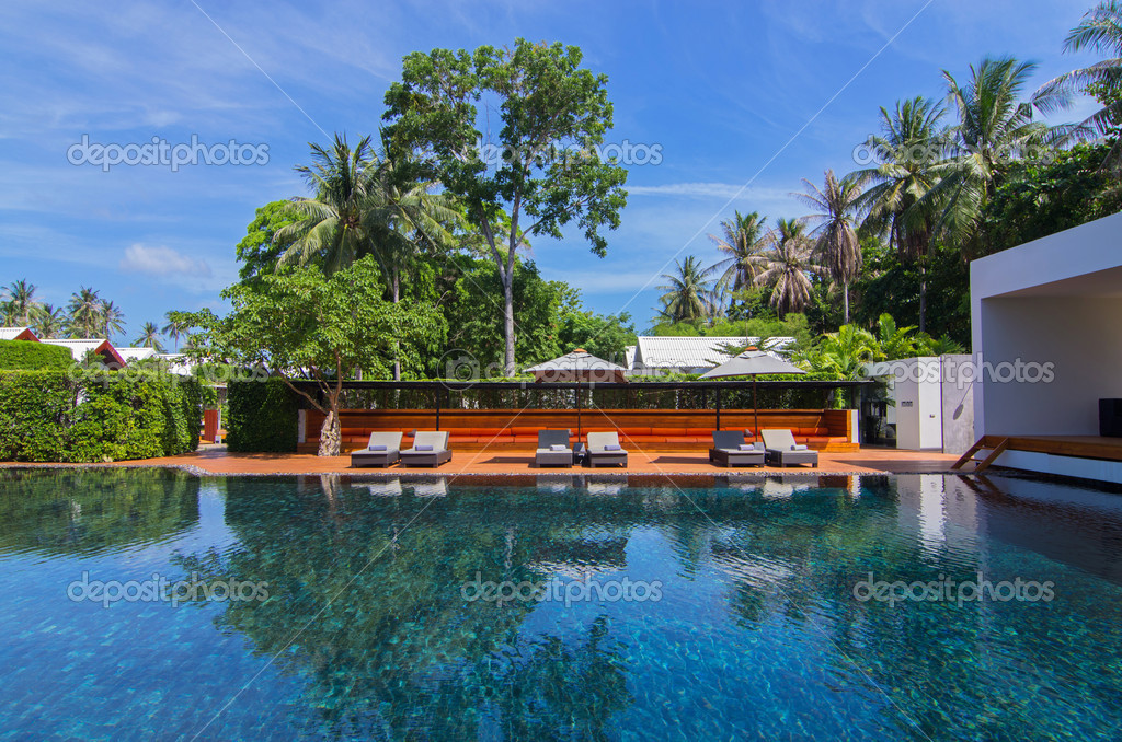 Beautiful Swimming Pool In Resort With Beach Chairs Near The Sea Stock Photo Tzido 32409227