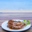 Fried prawns with tamarind sauce in plate with beach backgro — Stock fotografie #32484661